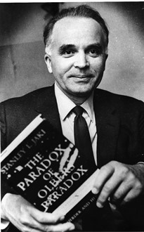 1969 – With a copy of <I>The Paradox of Olbers' Paradox