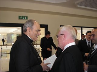H.E. Mgr. Marcelo Sanchéz Sorondo speaking with Father Teodóz Jáki