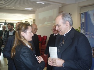 H.E. Mgr. Marcelo Sanchéz Sorondo speaking with Lucía Guerra Menéndez