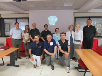 A group of speakers and participants at the end of the Summer Course