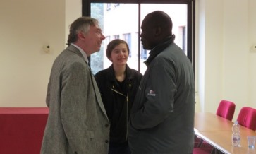 Neal and Priscilla Doran speaking with Fr Paul Abim.